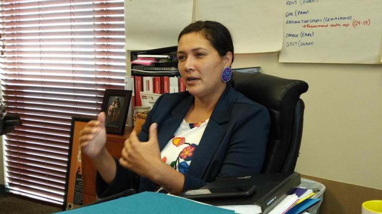 a woman sits behind a desk from the article 'Lead with compassion and love': Chief Linda Debassige on women in First Nations governance