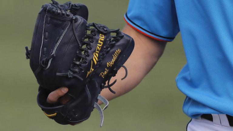 baseball glove from the article Ontario's back-to-school plan is straight out of the MLB's disastrous playbook