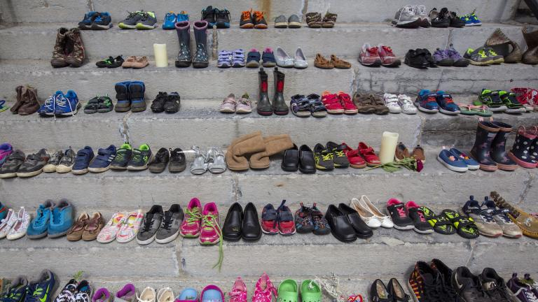 rows of children's shoes from the article Canada's treatment of Indigenous peoples fits the definition of genocide