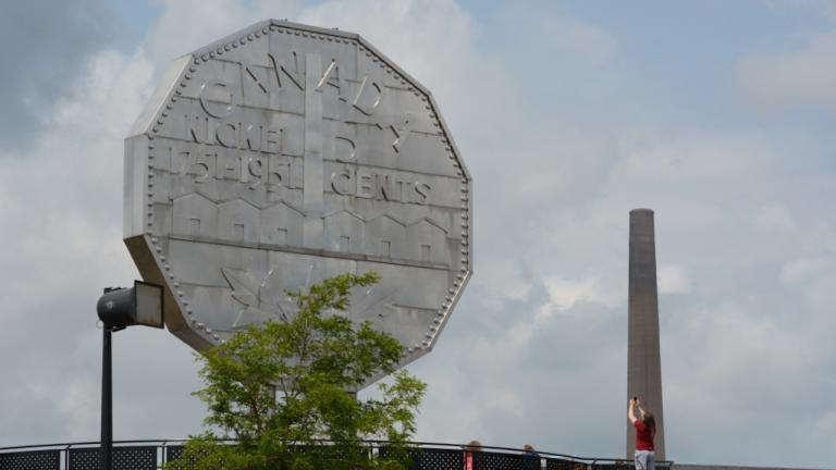 giant nickel on the left and smokestack on the right