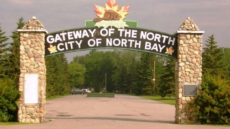 "sign reading ""Gateway to the North — City of North Bay"""