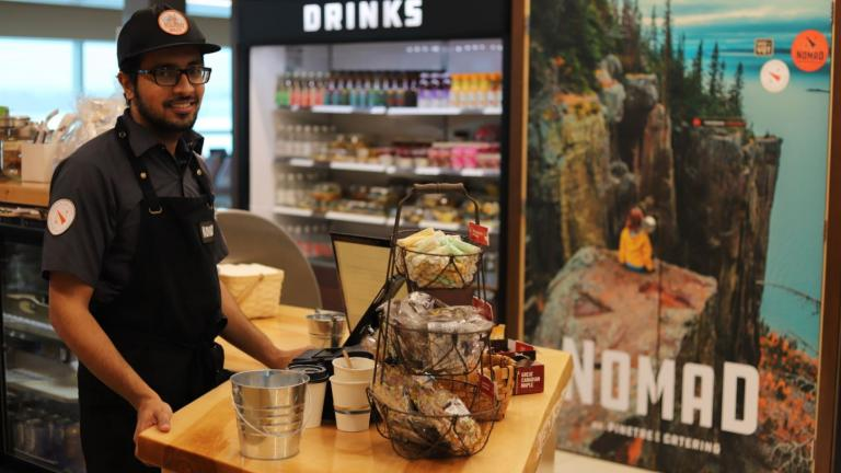 Man standing at counter in store from the article This Ontario airport traded big-name chains for local shops, and others are taking notice