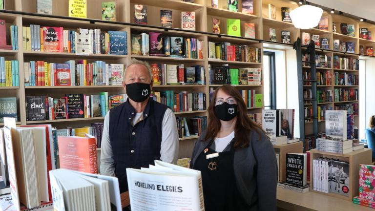 a masked man and woman stand in a bookstore from the article Peddie cash: What happens when a philanthropist tries to build 'the best small town in Ontario'