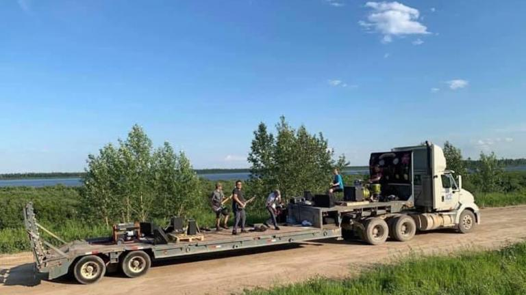 a band plays in the back of a truck from the article How Moose Cree First Nation and Moosonee quelled a COVID-19 outbreak