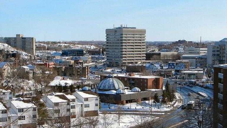 snow-covered buildings in a city's downtown from the article Are Torontonians going to gentrify northeastern Ontario?