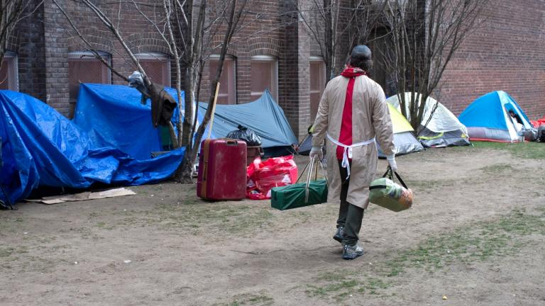 a person wearing PPE in a park from the article What Ontario is getting right (and wrong) about homelessness during COVID-19