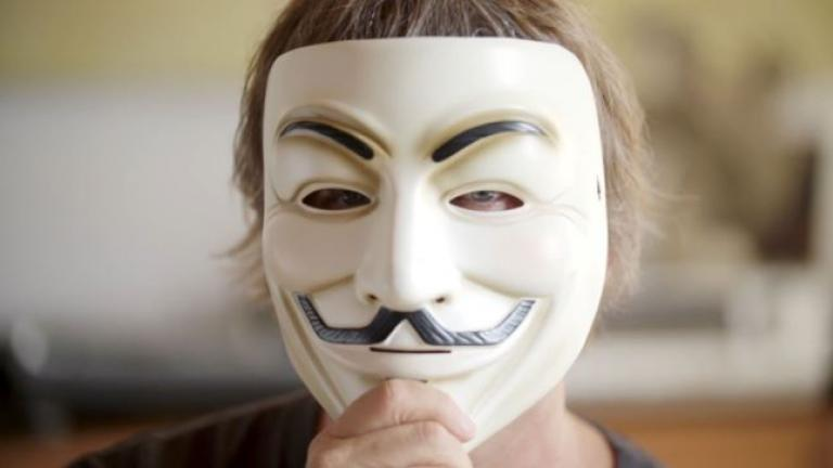 Christopher Doyon, also known as Commander X, poses in a Guy Fawkes mask
