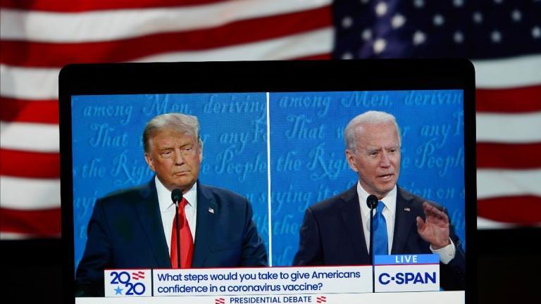Two men in a splitscreen on a monitor.