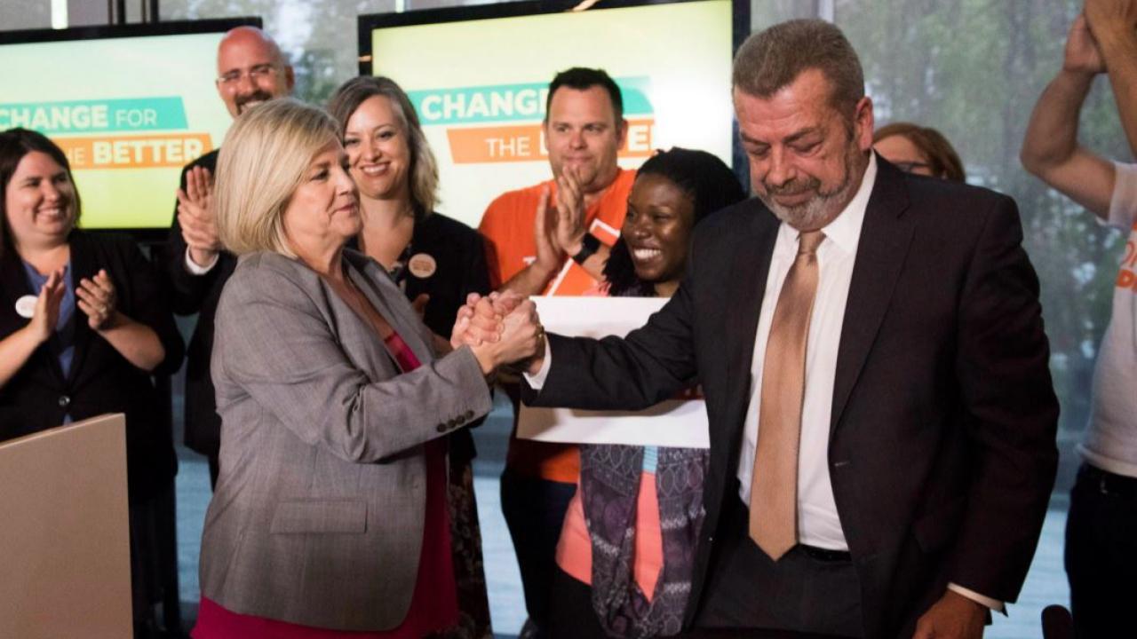 Andrea Horwath shakes hands with ETFO's Sam Hammond