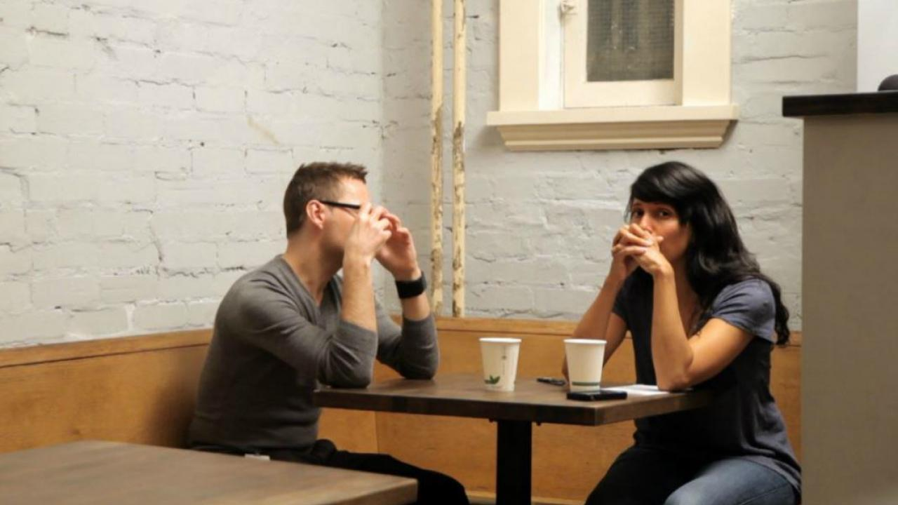 two people in a coffee shop