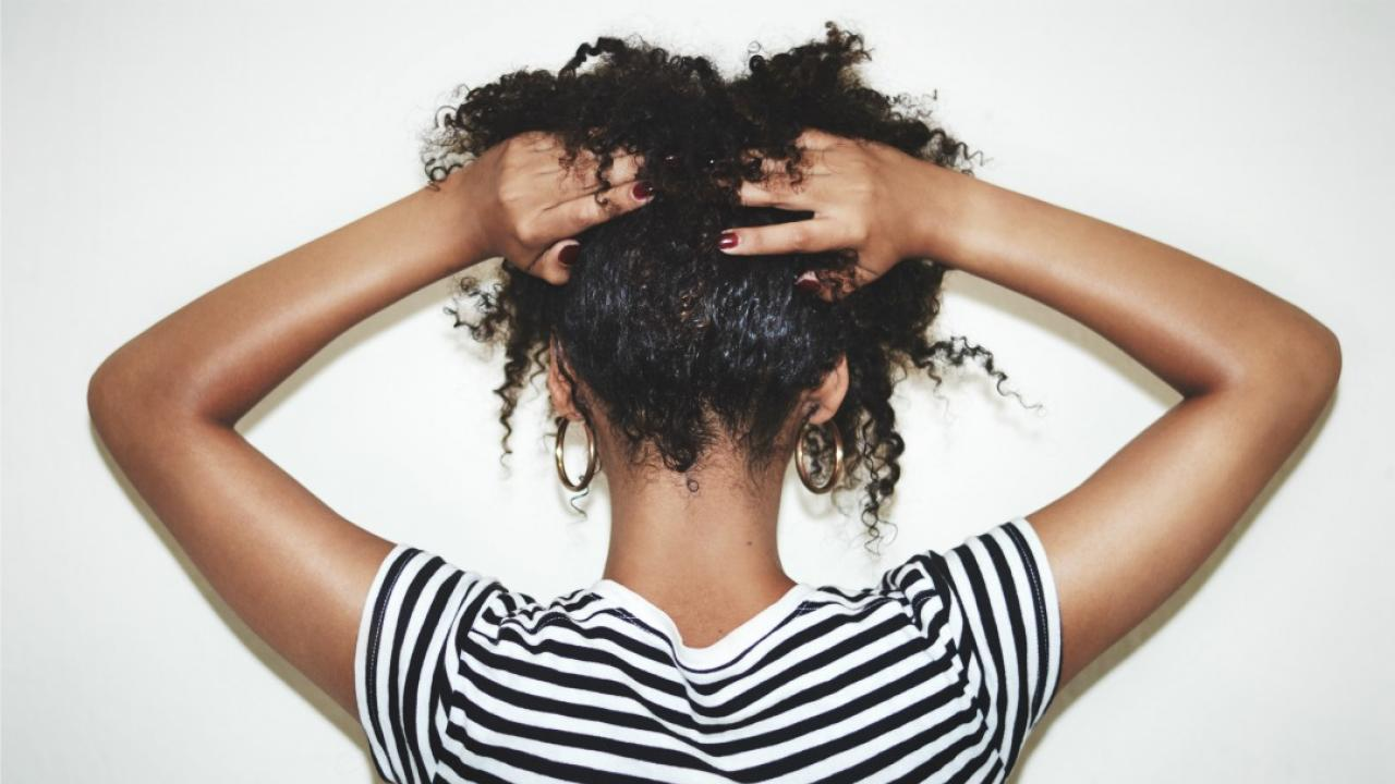 a woman holding her hair up