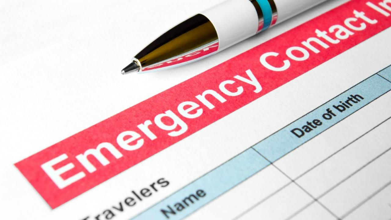 Emergency contact form and pen.