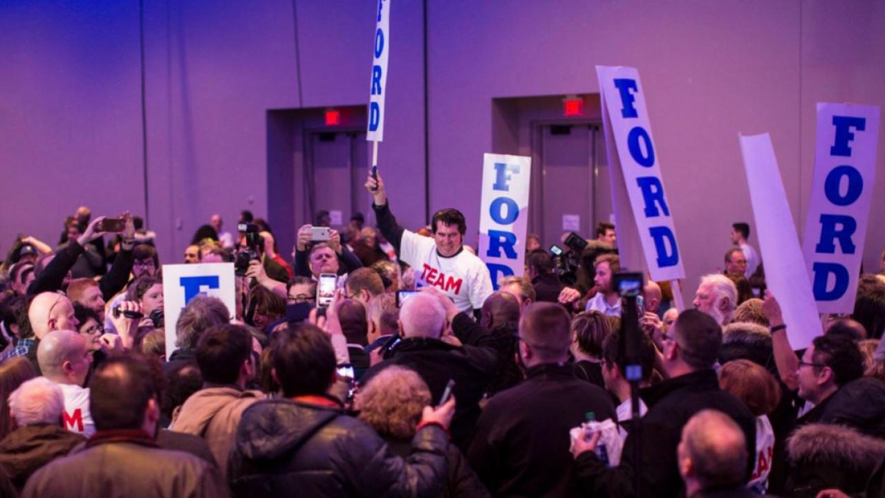 Doug Ford supporters holding up signs at a rally