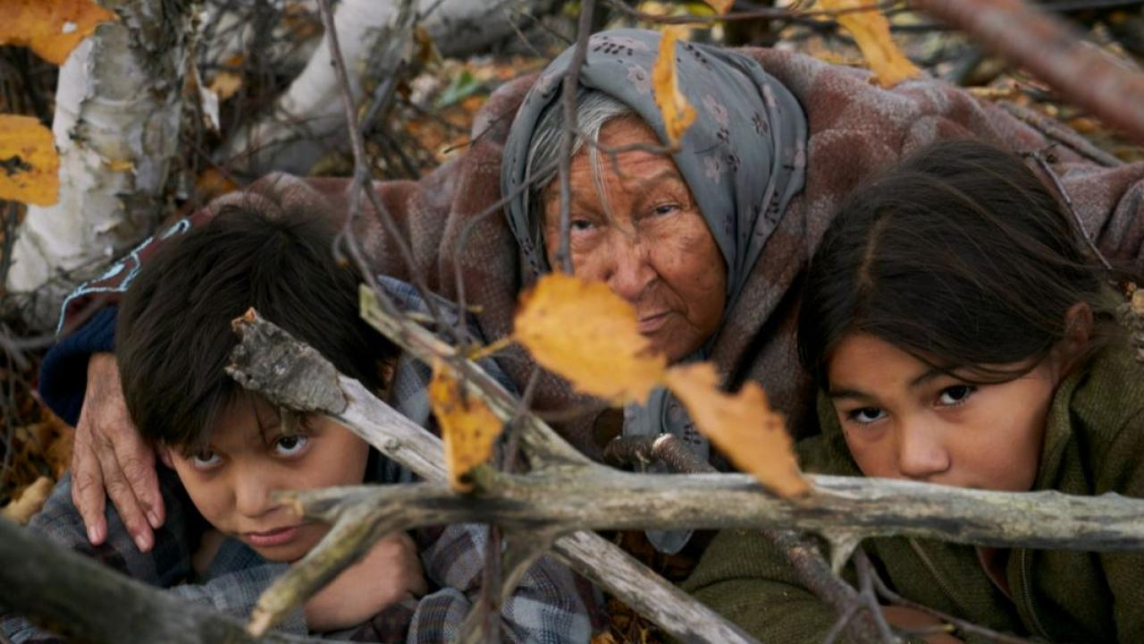 a woman hiding with two children