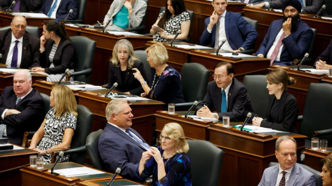Premier Doug Ford and members of the PC caucus in the Ontario legislature