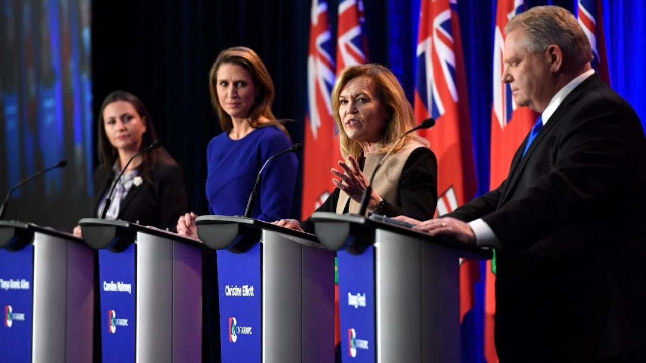 4 PC leadership hopefuls during a debate