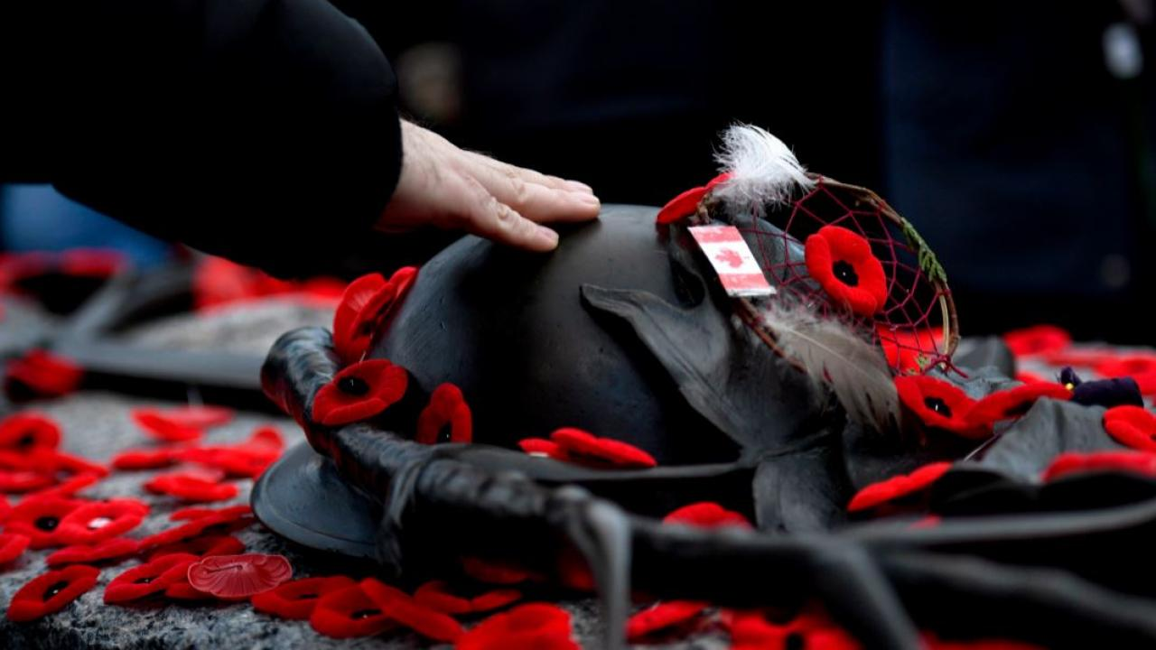 a person placing a poppy during Remembrance Day