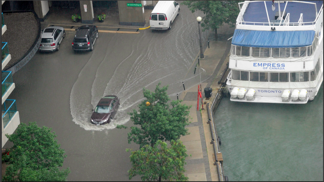 a flooded street and sidewalk in Toronto