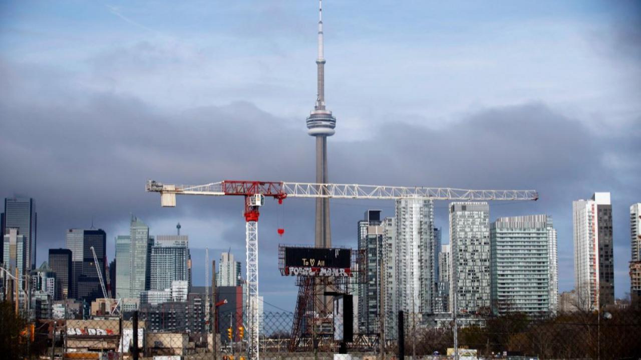 photo of Toronto skyline showing construction cranes