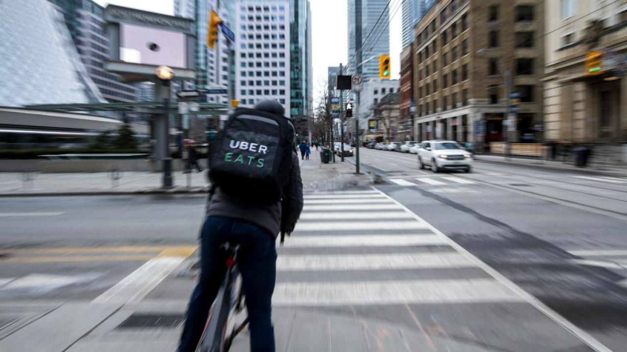 a person on a bike delivering food for UberEats