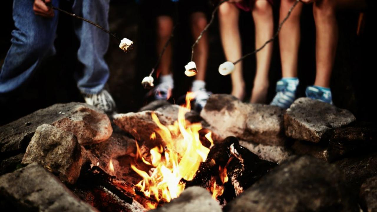 people roasting marshmallows over a campfire