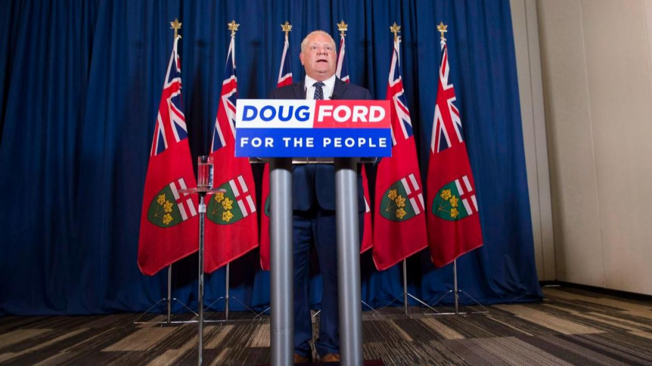 Doug Ford at a podium that says, For the People