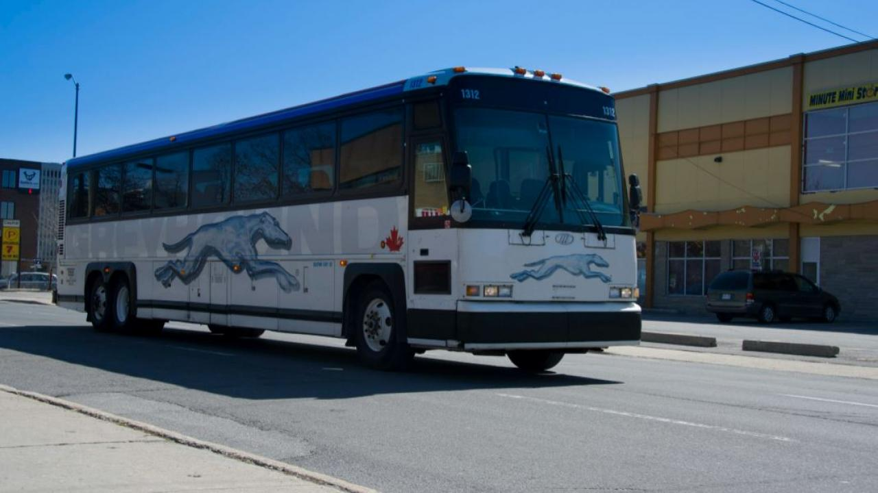 a Greyhound bus driving in Ontario