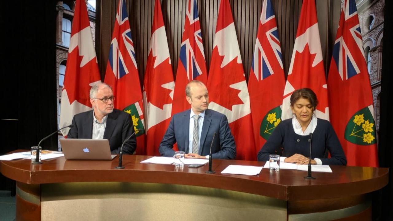 three officials at a media conference
