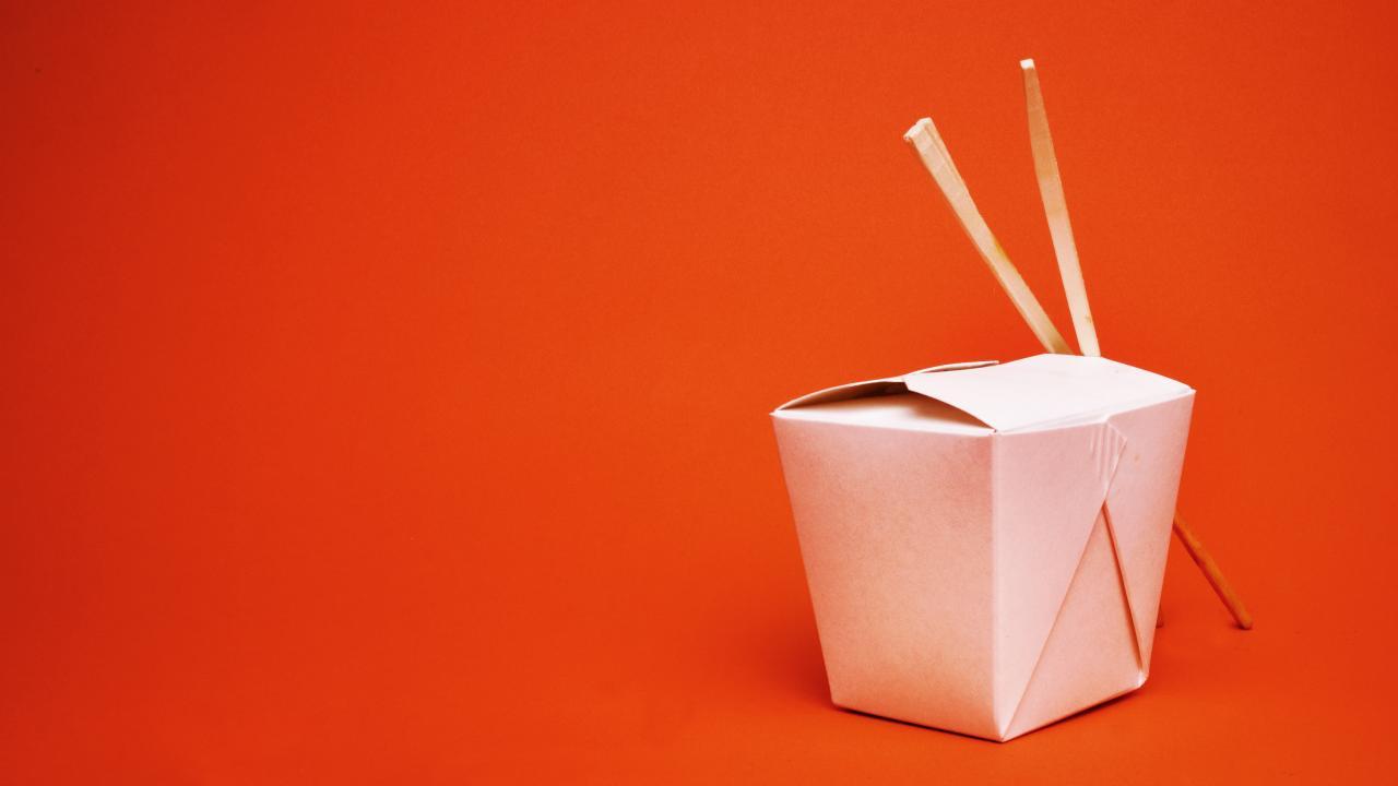 a food box with chopsticks