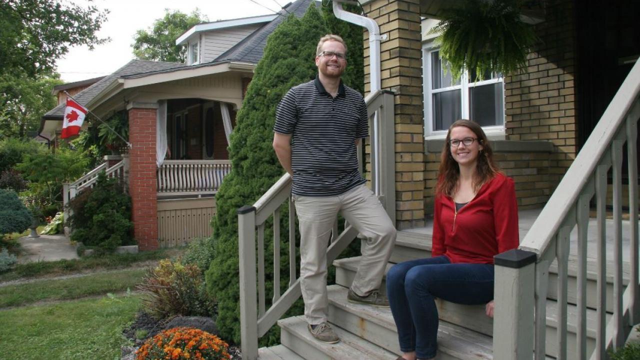 a couple on a house porch
