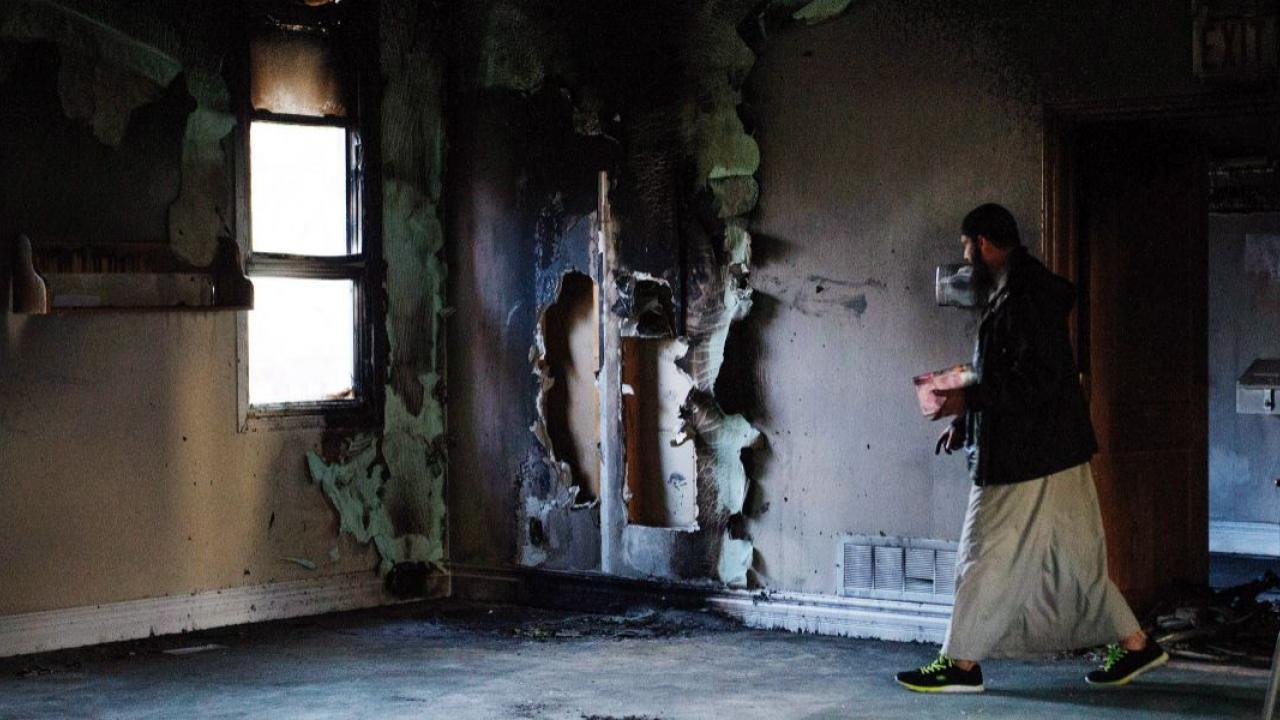 a man walking through a mosque