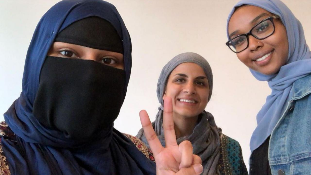 three people all wearing headscarves