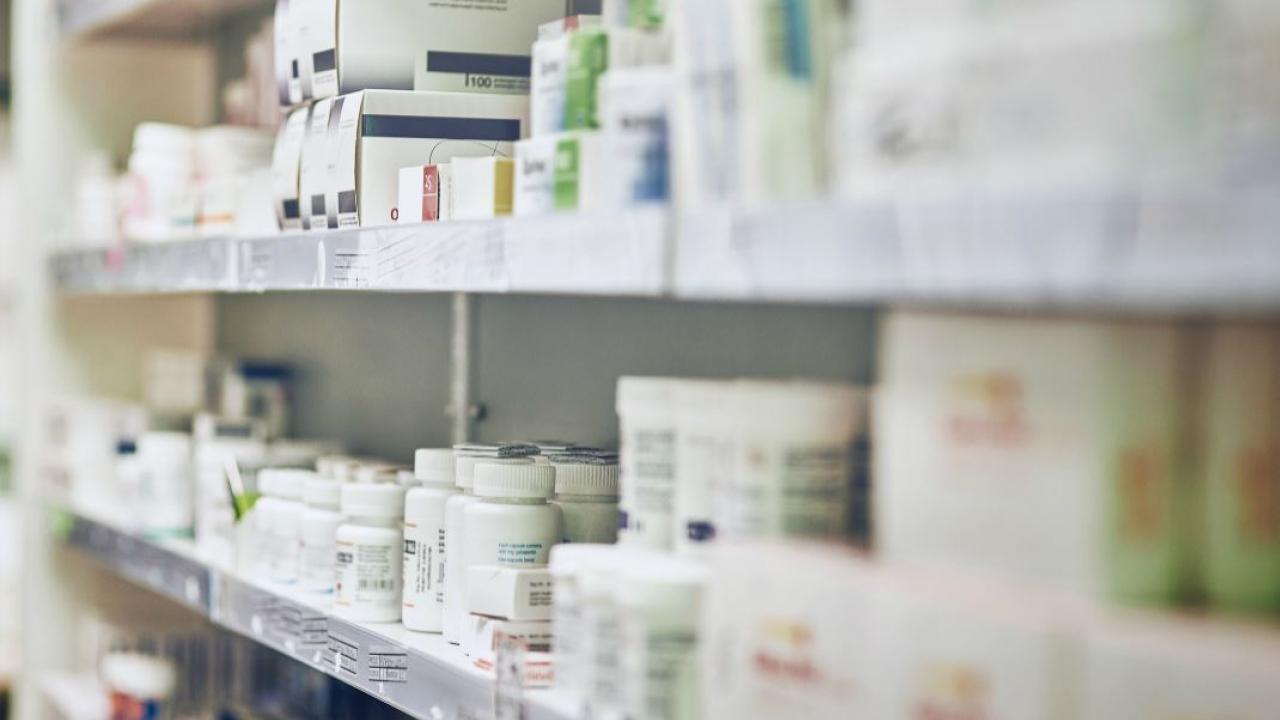 drugs arranged on a pharmacy shelf