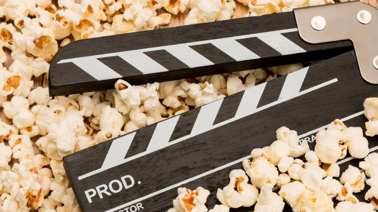 A movie clapper over popcorn