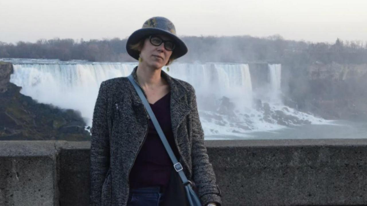 a woman standing in front of Niagara Falls