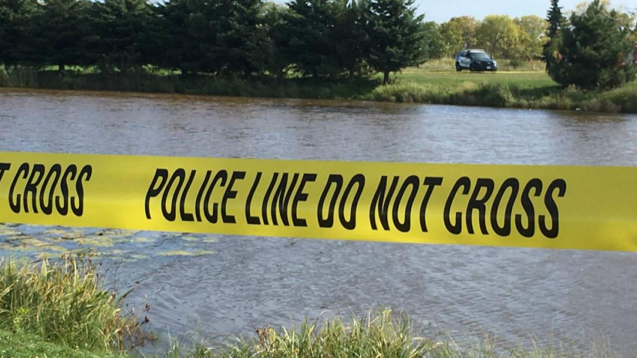 police tape at the edge of a river