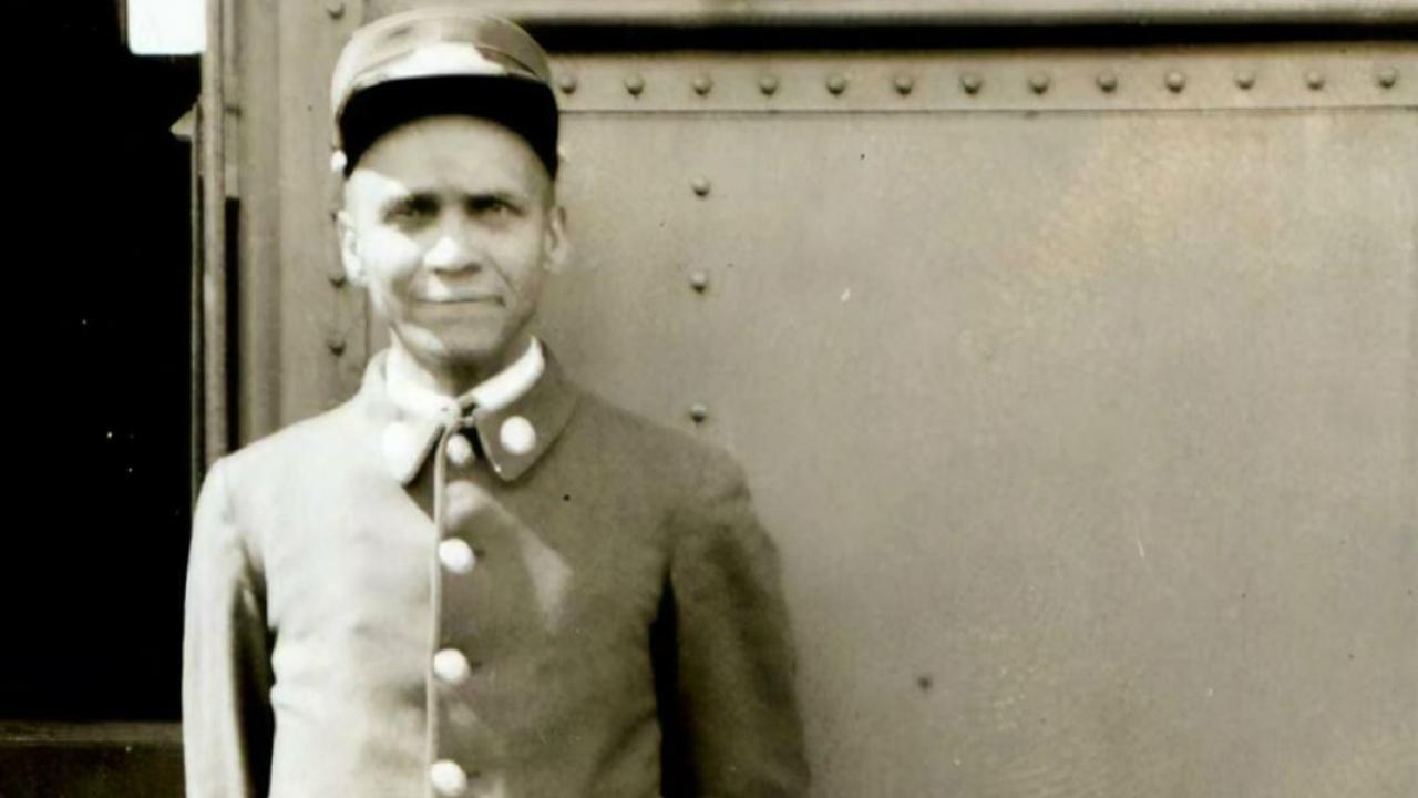 an archival photo of a train porter