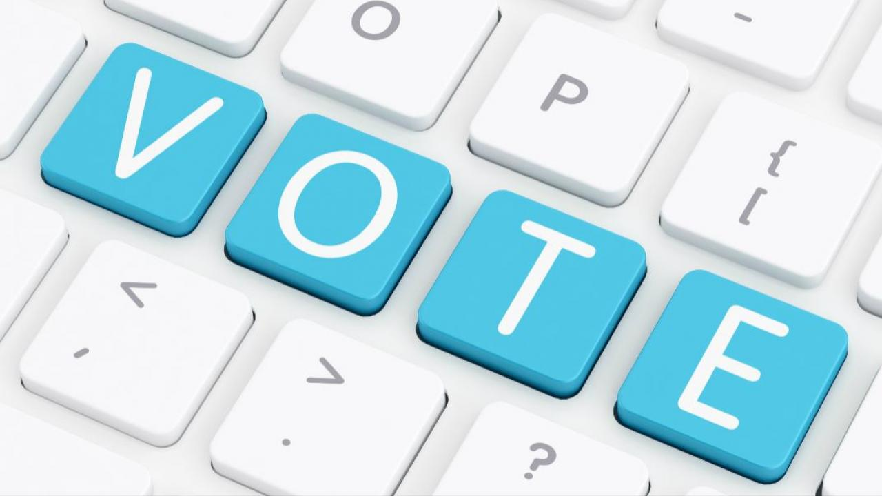 "the word ""vote"" spelled out on a computer keyboard"
