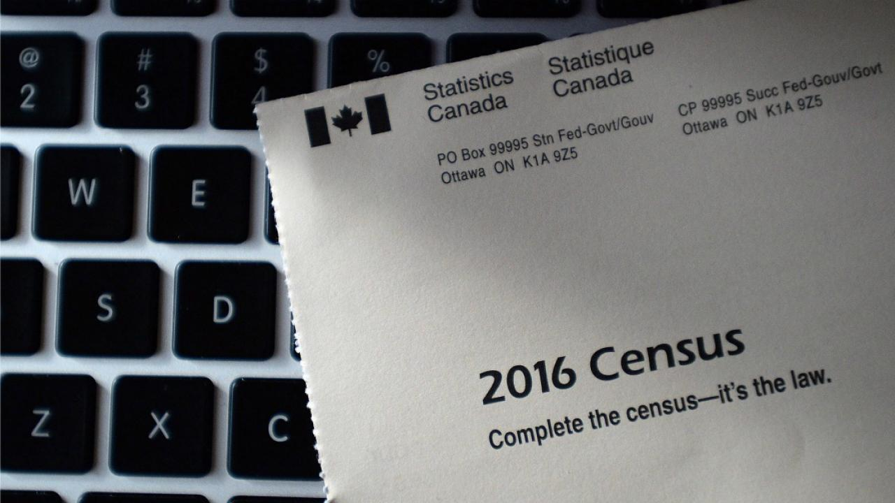 a census form resting on a computer keyboard