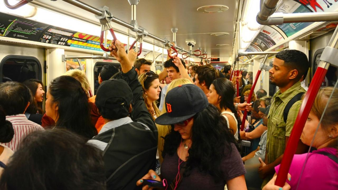 People standing in crowded subway car