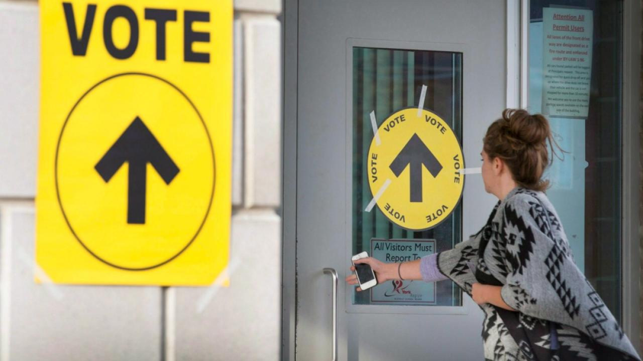 a woman entering a voting place on election day