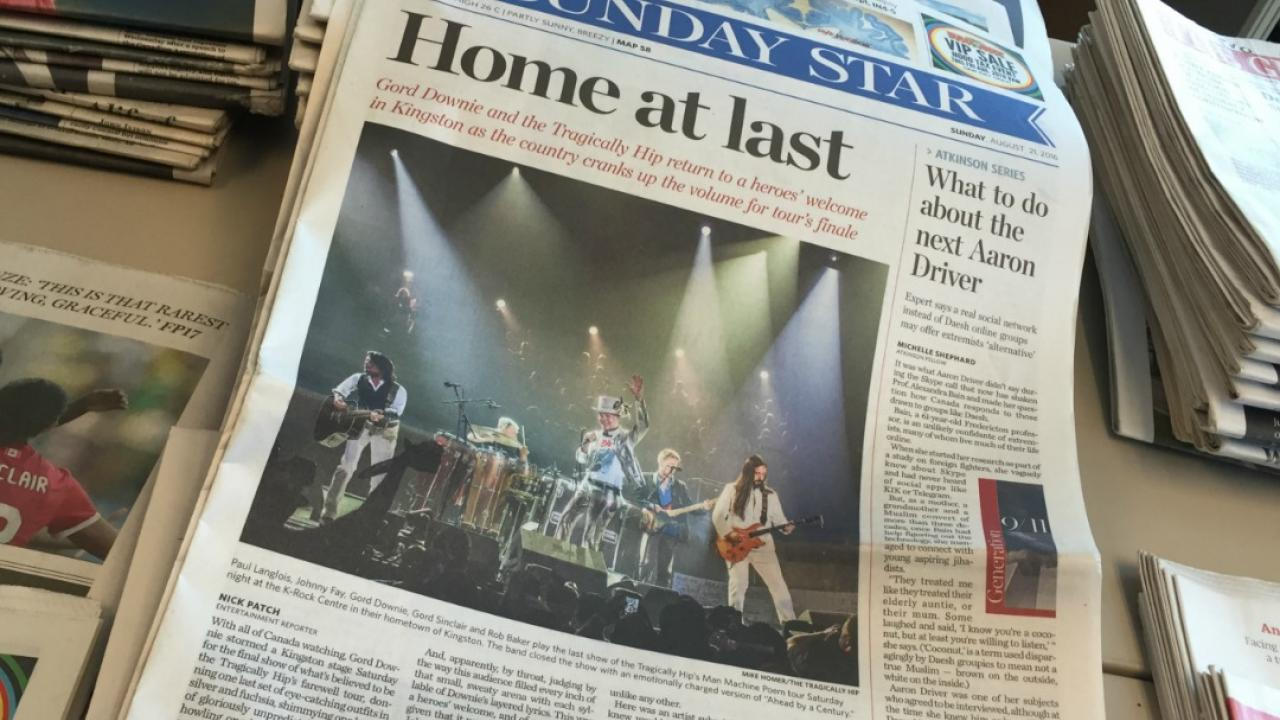 the front page of a newspaper featuring an article on the tragically hip