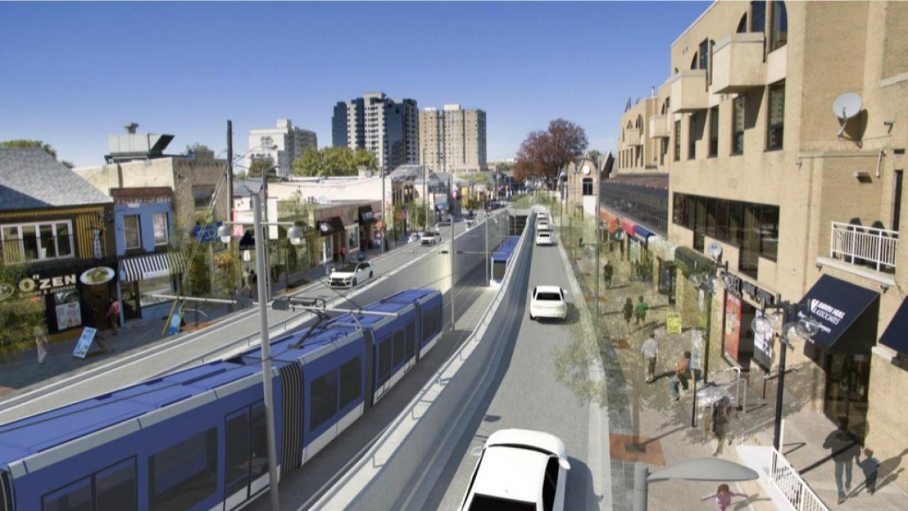 rendering of London rapid transit with train and roadways visible