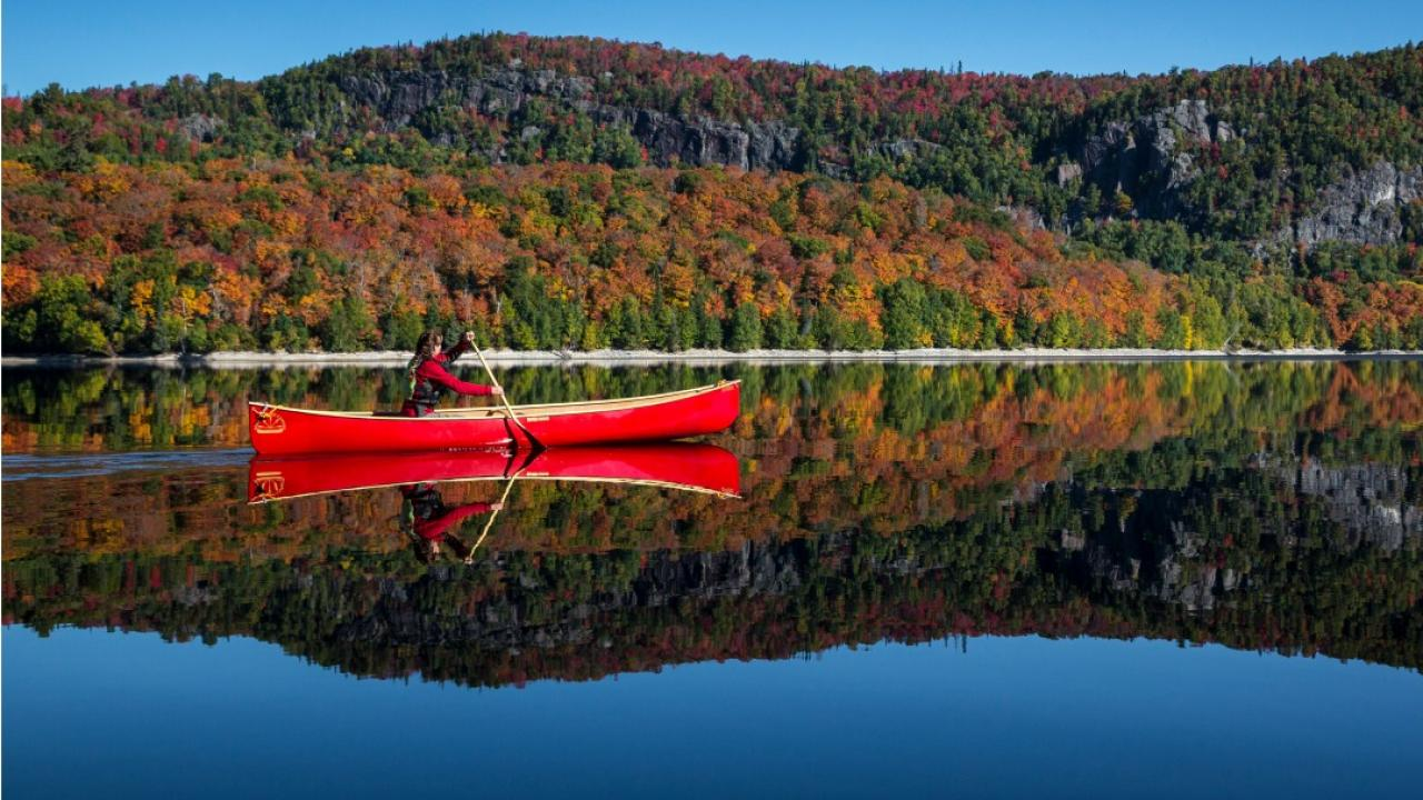 Author and photographer Joanie McGuffin in a canoe on the Montreal River.