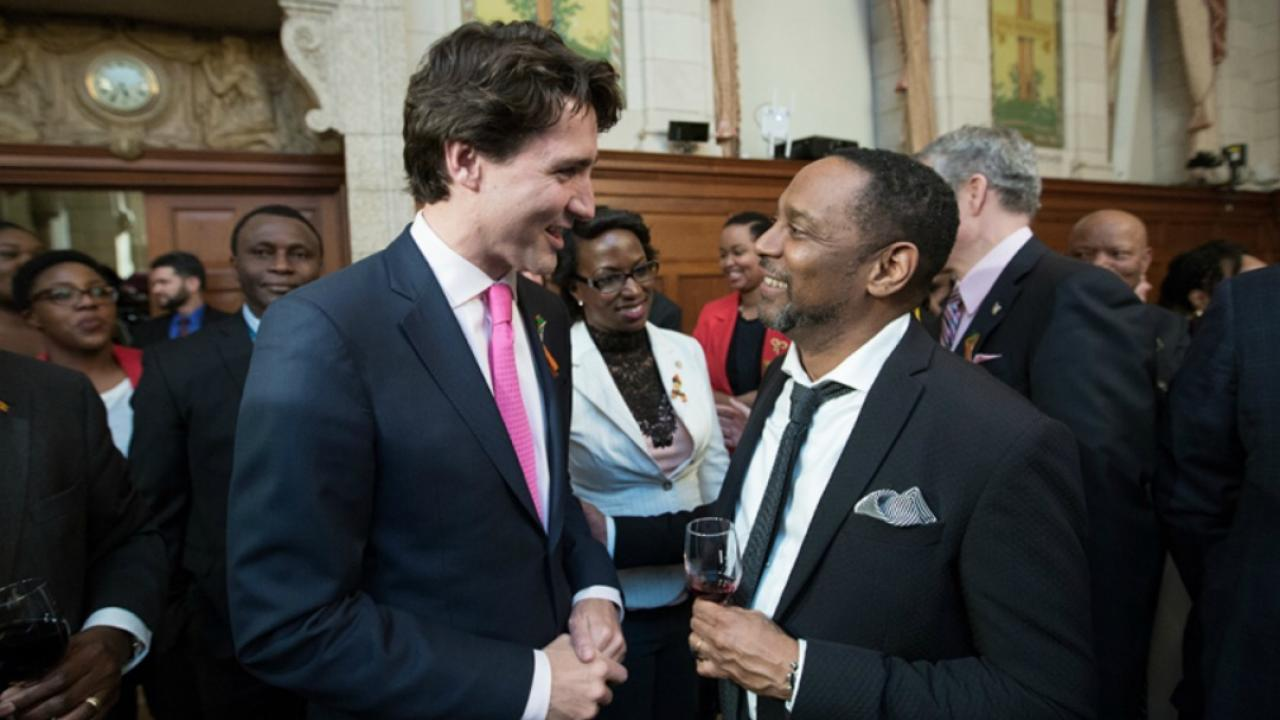 Justin Trudeau celebrating Black History Month with a crowd of people