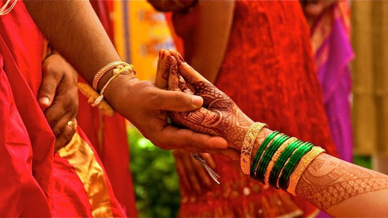 henna design on the arm of an Indian bride