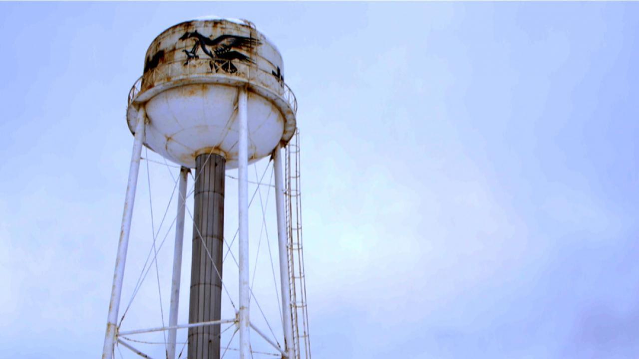 Moosonee's water tower on a blue sky