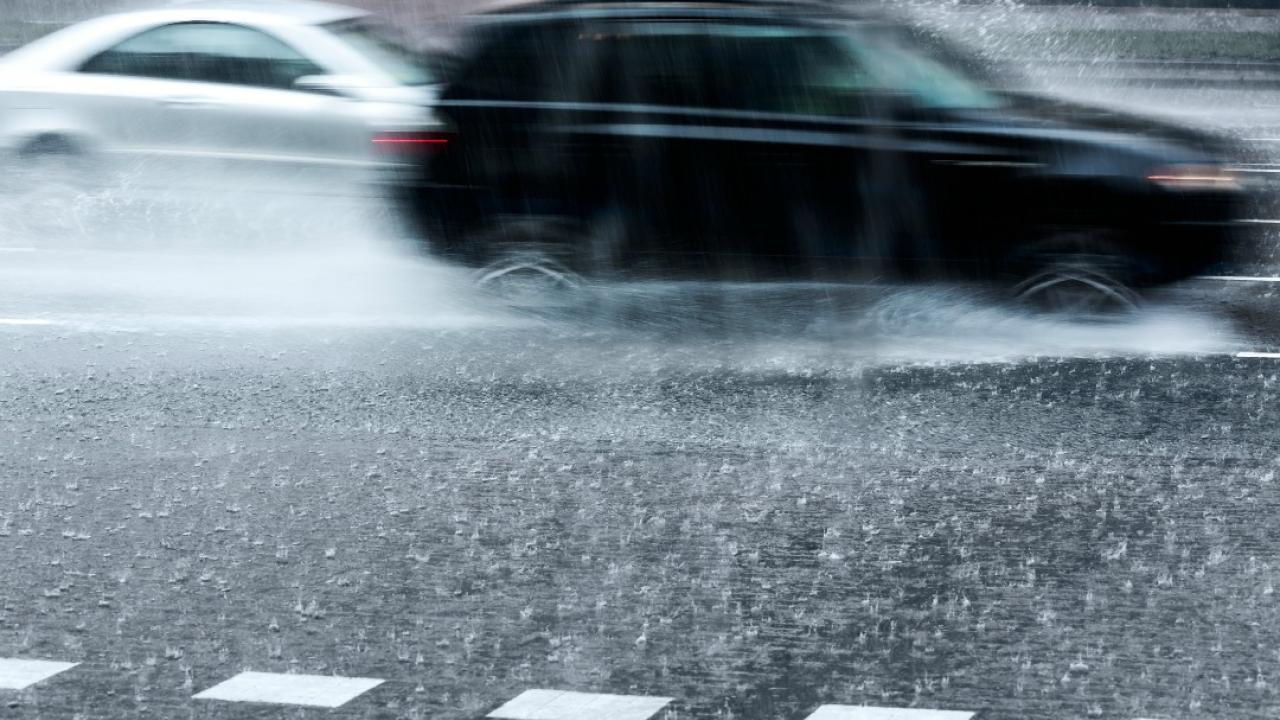 cars driving in torrential rain