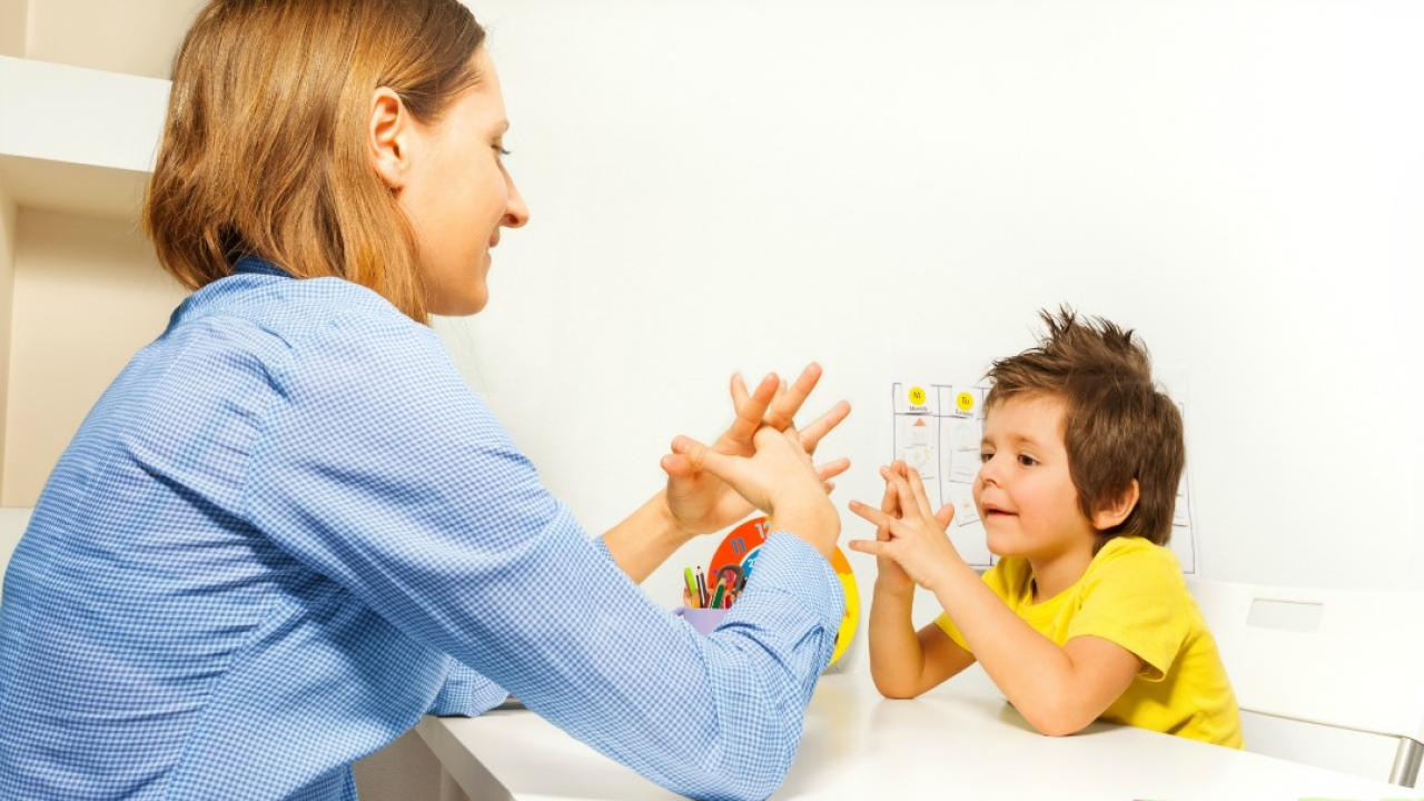 a therapist and child doing learning exercises