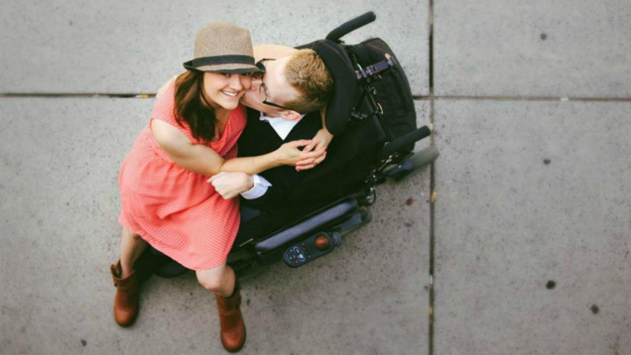 a couple embracing in a wheelchair